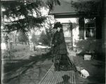 Woman on wooden walkway with dog