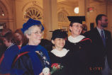 Graduation reception: two 1997 graduates and a faculty