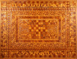 Marquetry tabletop associated with the Dennerlein family, Sheboyan, late nineteenth or early twentieth century.
